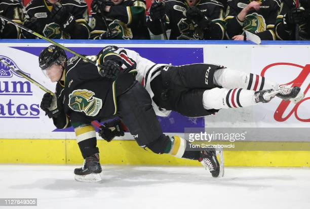 Zachary Roberts of the Guelph Storm lunges at Adam Boqvist of the London Knights as he misses a hit in the third period during OHL game action at...