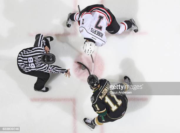 Zachary Roberts of the Owen Sound Attack takes a faceoff against Owen MacDonald of the London Knights during an OHL game at Budweiser Gardens on...