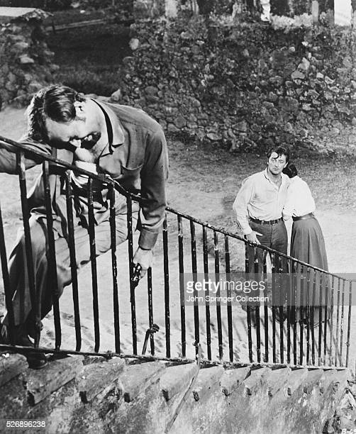 Zachary Scott as Kennedy and Robert Mitchum as Wilson in the 1956 film Bandido.