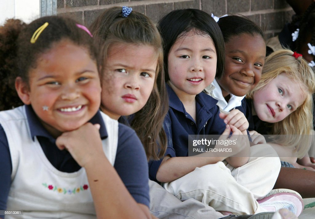 Girls take a break in the play yard at N : News Photo