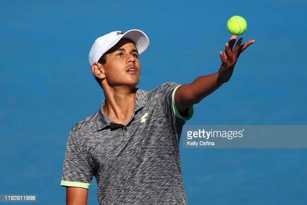 Zachary Viiala of Australia serves in the Boys 14 & U Singles Finals against Alexander Despoja of Australia during the 2019 Australian Open December...