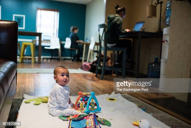 Zachary Vizcaino sixmonthsold plays on a mat while his mother Emily right works nearby They live in Chantilly VA Play Work or Dash LLC in Vienna...