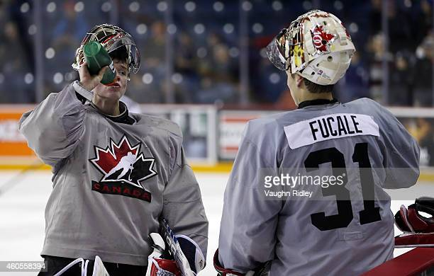 Zachery Fucale and Eric Comrie take a drinks break during the Canada National Junior Team practice at the Meridian Centre on December 16 2014 in St...