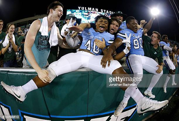 Zachery Harris of the Tulane Green Wave and Robert Kennedy celebrate after a game against the Louisiana-Lafayette Ragin Cajuns at Yulman Stadium on...