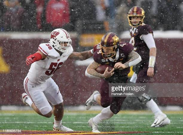 Zack Baun of the Wisconsin Badgers tackles Shannon Brooks of the Minnesota Golden Gophers during the second quarter of the game at TCF Bank Stadium...