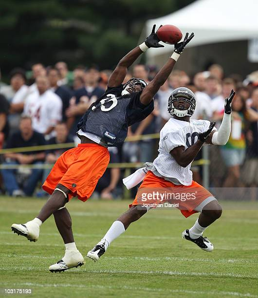 Zack Bowman of the Chicago Bears intercepts a pass intended for Earl Bennett during a summer training camp practice at Olivet Nazarene University on...