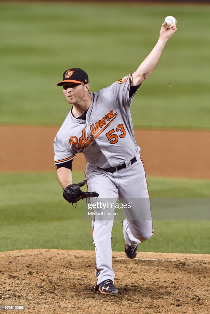Zach Britton #53 of the Baltimore Orioles pitches in the eighth inning during a baseball game against the Washington Nationals at Nationals Park on June 20, 2018 in Washington, DC.
