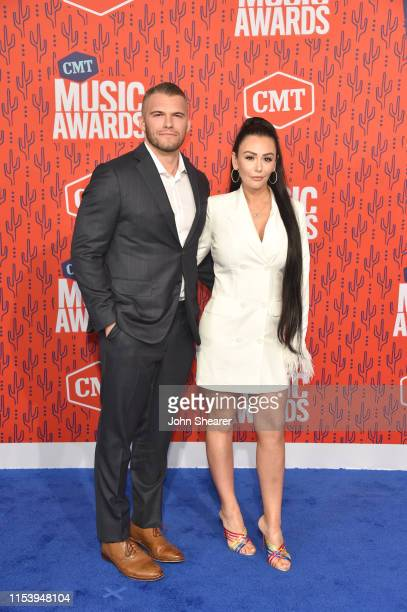 Zack Clayton Carpinello and JWoww attend the 2019 CMT Music Awards at Bridgestone Arena on June 05, 2019 in Nashville, Tennessee.