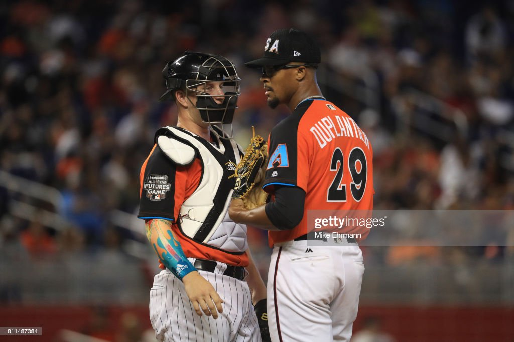 Zack Collins #8 of the Chicago White Sox and the U.S. Team and visits Jon Duplantier #29 of the Arizona Diamondbacks and the U.S. Team on the mound against the World Team during the SiriusXM All-Star Futures Game at Marlins Park on July 9, 2017 in Miami, Florida.