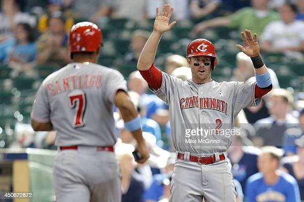 Zack Cozart of the Cincinnati Reds and Ramon Santiago celebrates after reaching home plate on a double hit by Todd Frazier in the top of the ninth...
