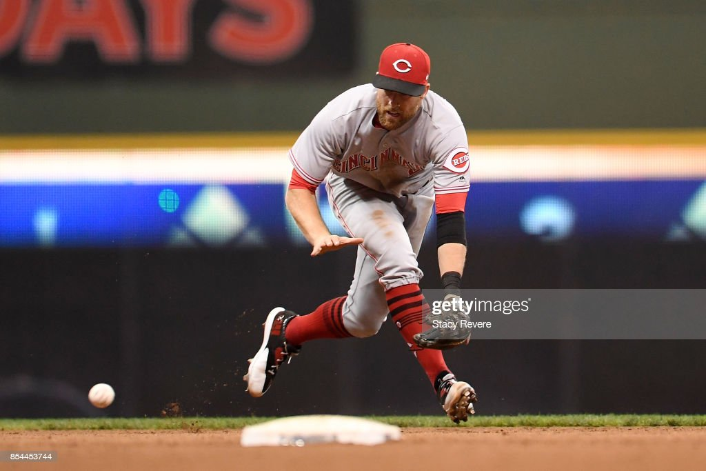 Zack Cozart #2 of the Cincinnati Reds fields a ground ball during the seventh inning of a game against the Milwaukee Brewers at Miller Park on September 26, 2017 in Milwaukee, Wisconsin.