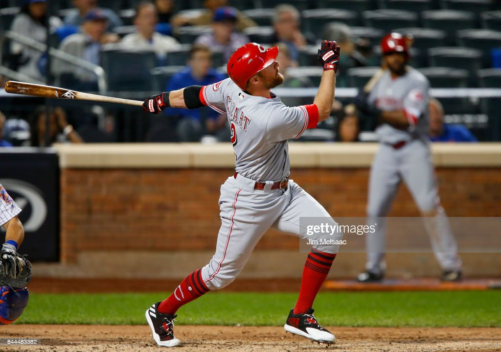 Zack Cozart #2 of the Cincinnati Reds follows through on a ninth inning run scoring sacrifice fly against the New York Mets at Citi Field on September 8, 2017 in the Flushing neighborhood of the Queens borough of New York City.