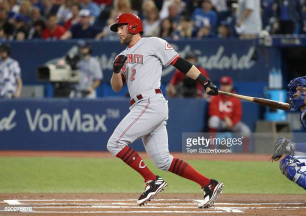 Zack Cozart of the Cincinnati Reds hits a single in the first inning during MLB game action against the Toronto Blue Jays at Rogers Centre on May 31...