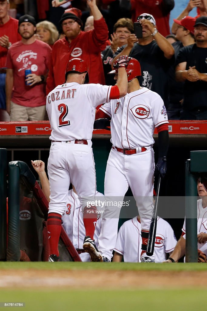 Zack Cozart #2 of the Cincinnati Reds is congratulated by Eugenio Suarez #7 of the Cincinnati Reds after hitting a home run during the third inning of the game against the Pittsburgh Piratesat Great American Ball Park on September 15, 2017 in Cincinnati, Ohio. Cincinnati defeated Pittsburgh 4-2.