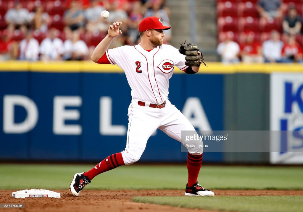 Zack Cozart #2 of the Cincinnati Reds loses control of the ball as he prepares to throw the ball in the third inning against the Chicago Cubs at Great American Ball Park on August 22, 2017 in Cincinnati, Ohio.