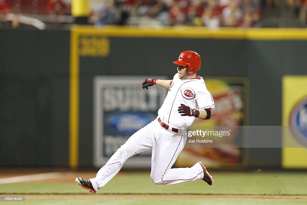Zack Cozart #2 of the Cincinnati Reds prepares to slide at third base after a triple to lead off the seventh inning of the game against the Cleveland Indians at Great American Ball Park on August 7, 2014 in Cincinnati, Ohio. The Reds won 4-0.