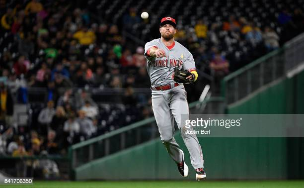 Zack Cozart of the Cincinnati Reds throws to first base for a force out of Elias Diaz of the Pittsburgh Pirates in the seventh inning during the game...