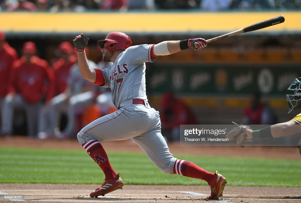 Zack Cozart #7 of the Los Angeles Angels hits a triple against the Oakland Athletics in the top of the first inning of a Major League Baseball game at Oakland Alameda Coliseum on March 31, 2018 in Oakland, California.