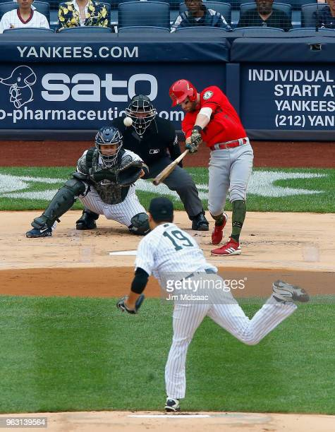 Zack Cozart of the Los Angeles Angels of Anaheim connects on a first inning single against Masahiro Tanaka of the New York Yankees at Yankee Stadium...