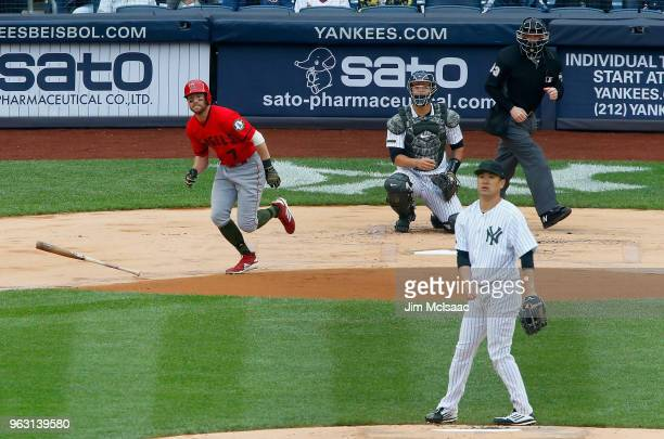 Zack Cozart of the Los Angeles Angels of Anaheim follows through on a first inning single against Masahiro Tanaka of the New York Yankees at Yankee...