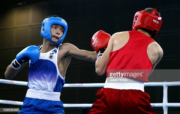 Zack Davies of Great Britain fights Shiva Thapa of India in the Bantam 54kg match during the boxing at the convention centre on August 22 2010 in...