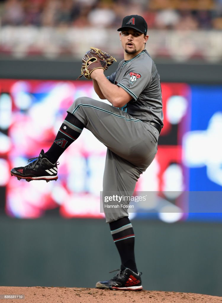 Zack Godley #52 of the Arizona Diamondbacks delivers a pitch against the Minnesota Twins during the first inning of the game on August 18, 2017 at Target Field in Minneapolis, Minnesota.