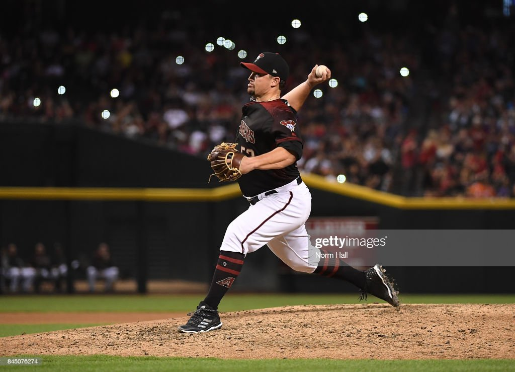 Zack Godley #52 of the Arizona Diamondbacks delivers a seventh inning pitch against the San Diego Padres at Chase Field on September 9, 2017 in Phoenix, Arizona.