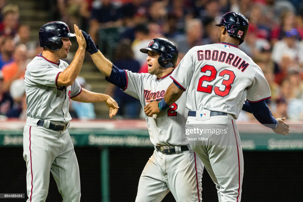 Zack Granite #8 and Niko Goodrum #23 celebrate with Brian Dozier #2 of the Minnesota Twins after all scored on a home run by Dozier during the eighth inning against the Cleveland Indians at Progressive Field on September 26, 2017 in Cleveland, Ohio.