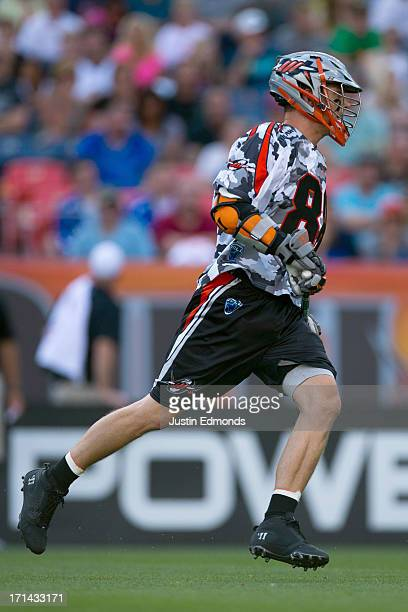 Zack Greer of the Denver Outlaws in action against the Ohio Machine at Sports Authority Field at Mile High on June 22 2013 in Denver Colorado The...