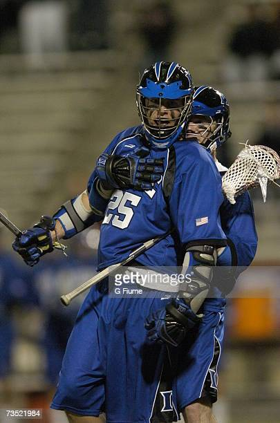 Zack Greer of the Duke Blue Devils is grabbed by a teammate after scoring against the Maryland Terrapins on March 2 2007 at Byrd Stadium in College...