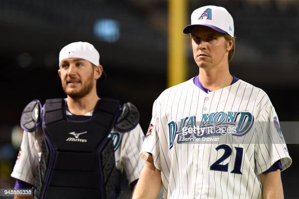 Zack Greinke and Jeff Mathis of the Arizona Diamondbacks prepare for the MLB game against the San Francisco Giants at Chase Field on April 19 2018 in...
