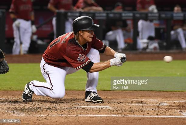 Zack Greinke of the Arizona Diamondbacks drops down a bunt during the third inning against the San Diego Padres at Chase Field on July 8 2018 in...