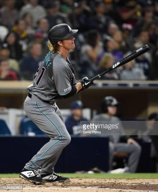 Zack Greinke of the Arizona Diamondbacks hits a threerun home run during the fourth inning of a baseball game against the San Diego Padres at Petco...