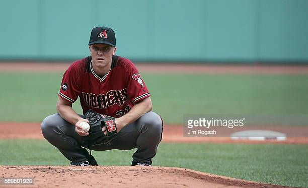 Zack Greinke of the Arizona Diamondbacks prepares to throw against the Boston Red Sox in the first inning at Fenway Park on August 14 2016 in Boston...