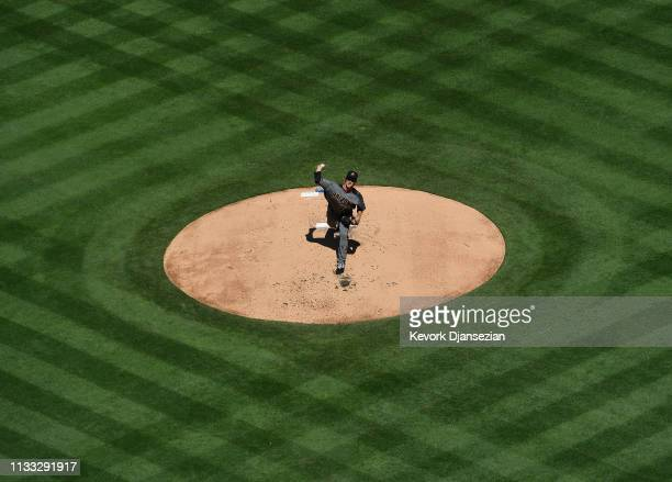 Zack Greinke of the Arizona Diamondbacks throws a pitch against Los Angeles Dodgers during the first inning on Opening Day at Dodger Stadium on March...