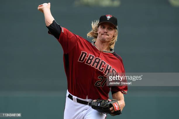 Zack Greinke of the Arizona Diamondbacks throws a warm up pitch during the spring training game against the Cleveland Indians at Salt River Fields at...