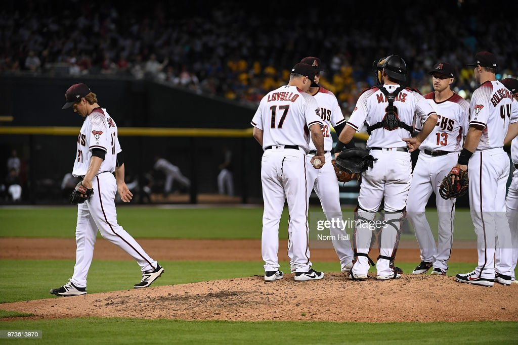 Zack Greinke #21 of the Arizona Diamondbacks walks off the mound and back to the dugout after being removed from the game in the fourth inning against the Pittsburgh Pirates at Chase Field on June 13, 2018 in Phoenix, Arizona.