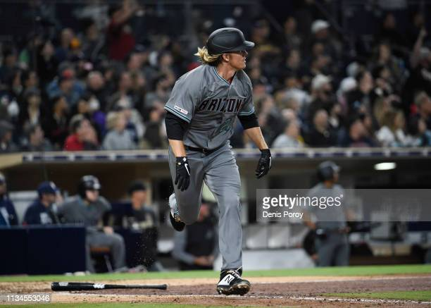 Zack Greinke of the Arizona Diamondbacks watches the flight of his solo home run during the sixth inning of a baseball game against the San Diego...