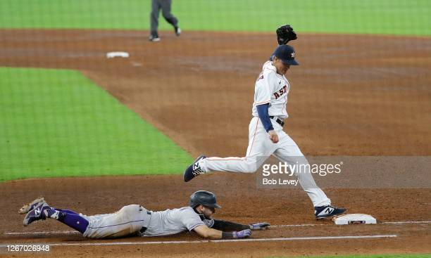 Zack Greinke of the Houston Astros beats Garrett Hampson of the Colorado Rockies to the base in the sixth inning at Minute Maid Park on August 18,...