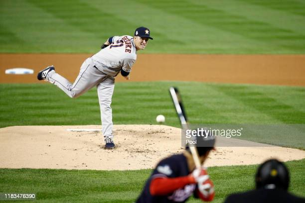 Zack Greinke of the Houston Astros delivers the pitch to Anthony Rendon of Washington Nationals during the first inning in Game Three of the 2019...
