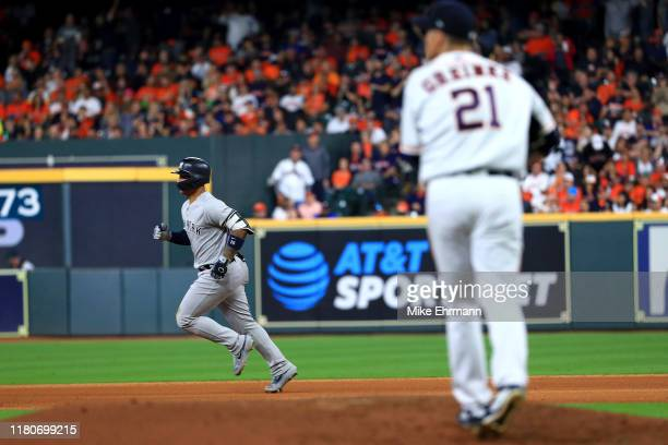 Zack Greinke of the Houston Astros reacts as Gleyber Torres of the New York Yankees rounds the bases following his solo home run during the sixth...