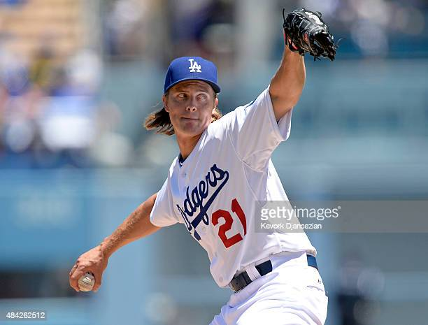 Zack Greinke of the Los Angeles Dodgers pitches the Cincinnati Reds during the first inning at Dodger Stadium August 16 in Los Angeles California