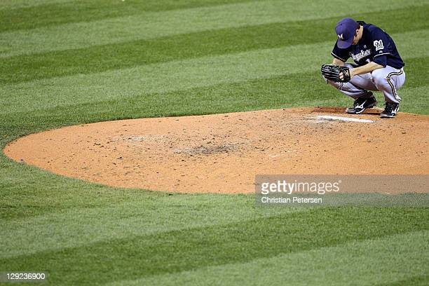 Zack Greinke of the Milwaukee Brewers crouches on the mond against the St Louis Cardinals during Game Five of the National League Championship Series...