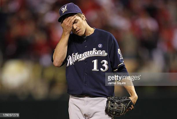 Zack Greinke of the Milwaukee Brewers reacts after Matt Holliday of the St Louis Cardinals reaches on an infield single in the bottom of the fifth...