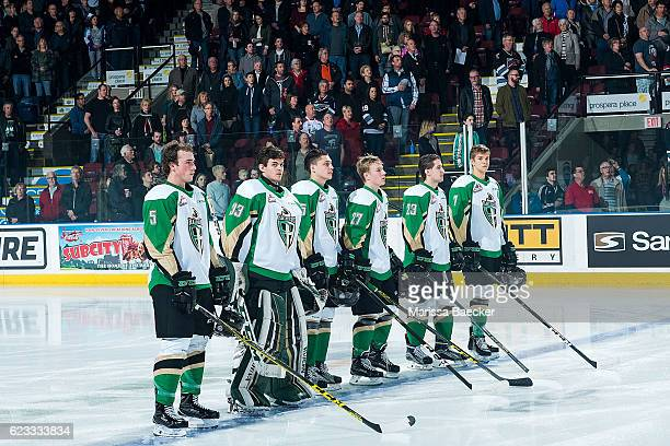 Zack Hayes Ian Scott Austin Glover Parker Kelly Simon Stransky and Brendan Guhle of the Prince Albert Raiders stand on the blue line at the start of...