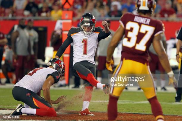 Zack Hocker of the Bucs attempts a field goal from the hold of Bryan Anger but gets too much turf and misses during the NFL Preseason game between...
