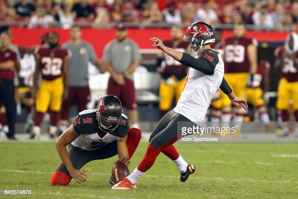 Zack Hocker of the Bucs kicks a field goal from the hold of Bryan Anger during the NFL Preseason game between the Washington Redskins and the Tampa...