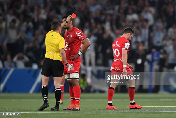 Zack Holmes of Toulouse is shown a red card by Referee, Luke Pearce for high tackle during the Heineken Champions Cup Quarter Final match between...