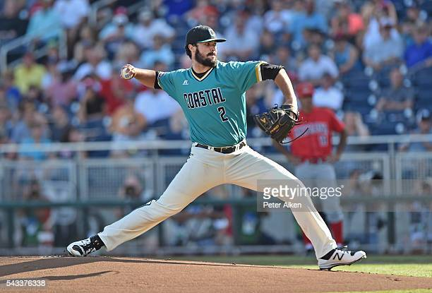 Zack Hopeck of the Coastal Carolina Chanticleers delivers a pitch against the Arizona Wildcats in the first inning during game one of the College...
