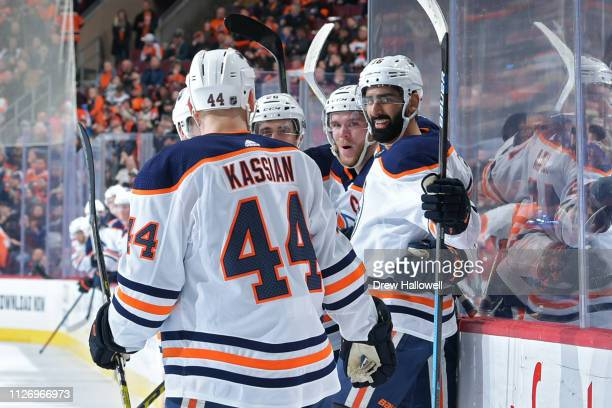 Zack Kassian Brandon Manning Connor McDavid and Jujhar Khaira of the Edmonton Oilers celebrate a first period goal against the Philadelphia Flyers at...